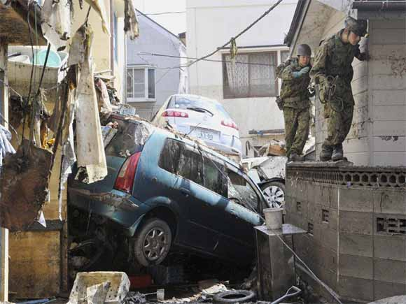 destroyed cars on road
